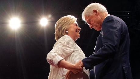 Hillary Clinton greets her husband Bill Clinton on stage during an election night rally on June 7, 2016, in New York.