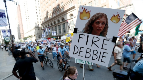 A supporter of Sen. Bernie Sanders holds up a sign call calling for Debbie Wasserman Schultz, chairwoman of the Democratic National Committee to be fired, Sunday, July 24, 2016, in Philadelphia. Schultz did announce her resignation Sunday evening amid controversy over leaked emails from the DNC.