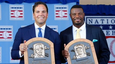 Mike Piazza (L) and Ken Griffey Jr. pose after being inducted into the Baseball Hall of Fame before a crowd of approximately 50,000 in Cooperstown, New York.