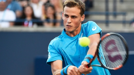 Canada's Vasek Pospisil moved on at the Rogers Cup after Frenchman Jeremy Chardy was forced to quit because of an injury.