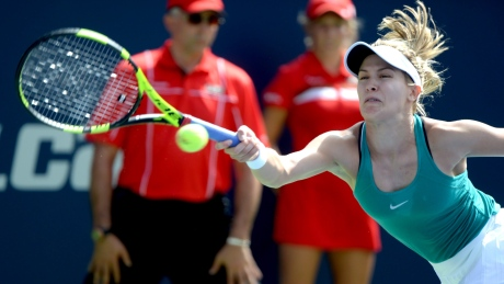 Canada's Eugenie Bouchard stretches for a return against Lucie Safarova of the Czech Republic during her first-round win Tuesday at the Rogers Cup in Montreal.
