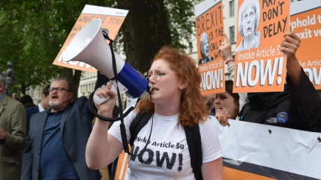 Pro-brexit demonstrators protest outside Downing Street following the arrival of new Prime Minister Theresa May at Number 10 on July 13, 2016 in London. Demonstrators urged Ms May to invoke Article 50 which would trigger the UK's withdrawal from the European Union.