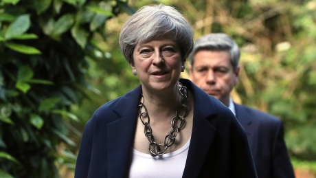 Britain's Prime Minister Theresa May arrives to attend Holy Communion at St Andrew's Church in Sonning, Berkshire, England, Sunday, June 11, 2017. May is under pressure after the Conservatives lost their parliamentary majority in Thursday's election.